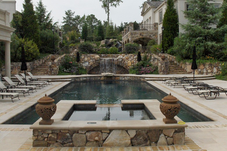 Formal Swimming Pool with Jacuzzi and Stone Waterfall, Garden Architects, Inc.